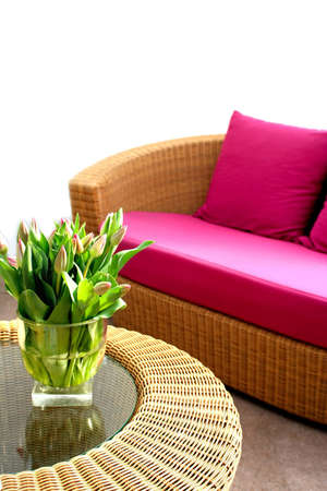 tulips in interior with wooden garden furniture photo