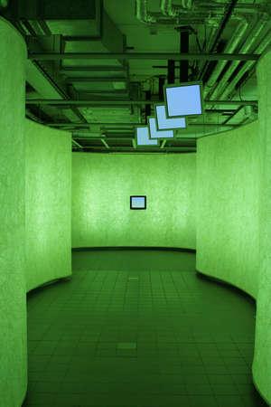 urbanistic: urbanistic corridor with information TVs in green light