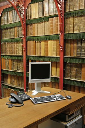 scholarship: antique library with modern computer Stock Photo