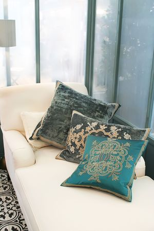 classic lounge with decorative pillows by morning