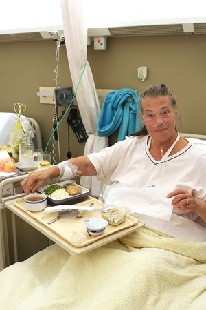 patient in hospital room in during dinner time Stock Photo