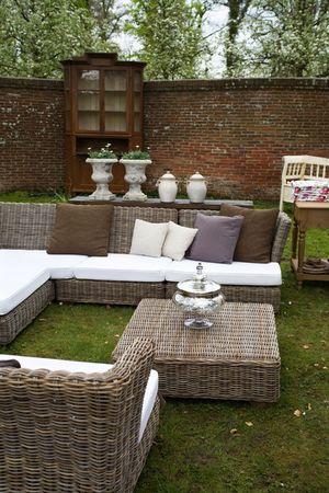 spring decorated garden furniture in backyard  photo