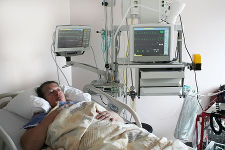 Cardiology patient in intensive care department of hospital