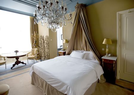 bedding indoors: hotel bedroom in classic style interior