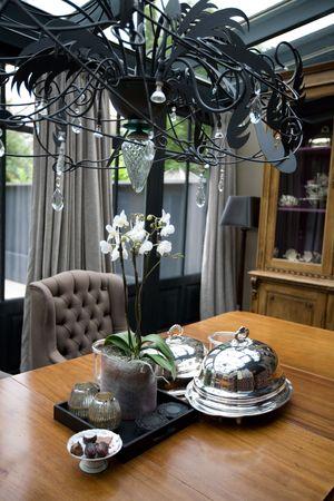 dinner table in decorative interior photo