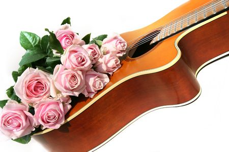 acoustics: flowers and acoustics guitar on white