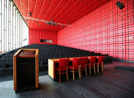confer: red decorated interior for conference hall Stock Photo