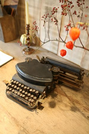 fall  arrangement on wooden table with typewriter photo