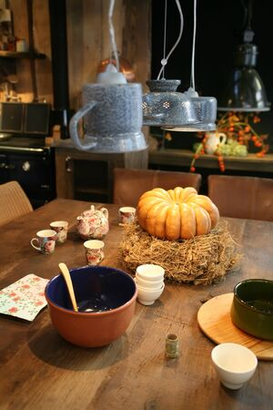 table with pumpkin in country kitchen photo