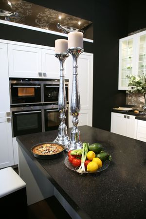 kitchen decoration by vegetables and kitchenware photo