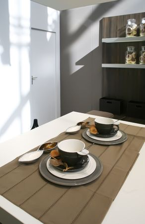 kitchen table with tea cups   photo