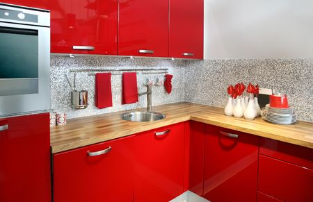 modern red kitchen with flowers decoration