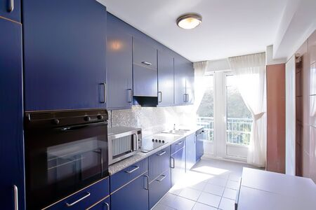 Blue kitchen in empty apartment Stock Photo - 5750839
