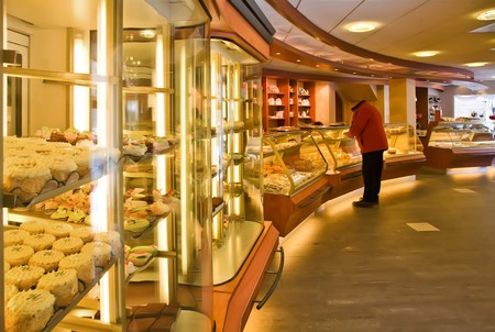 candy shop: interior of bakery shop with customer