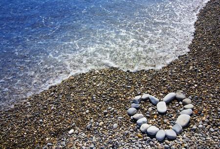 symbol of heart on beach photo
