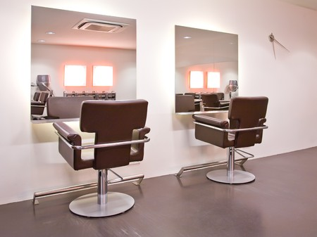 hairdressing scissors: interior with chairs in new beauty salon  Stock Photo