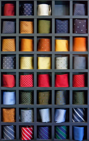 background of different colors ties in special box photo
