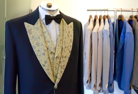 man dress and shirts in atelier room photo
