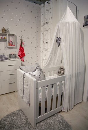 interior of designed in white color baby room photo