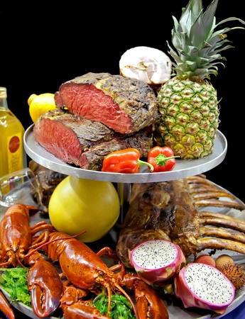 meat and sea food in assortment on tray