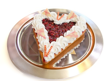Berries tart in heart form photo