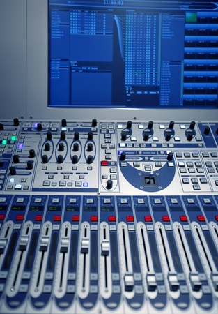 music production: studio music mixer with comuter screen Stock Photo