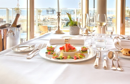 luxury salmon plate in restaurant by sea photo