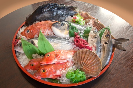 raw fish on tray photo