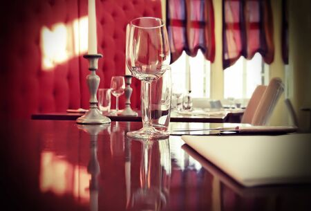 restaurant setting: glass on restaurant table in red interior
