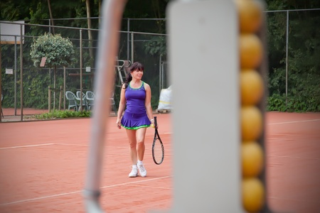 living moment: woman playing  tennis Stock Photo