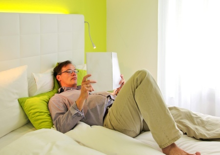 reading man on hotel bad Stock Photo - 10536915