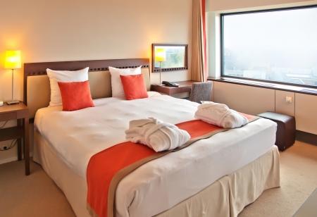 hotel bedroom: modern bedroom in hotel room Stock Photo
