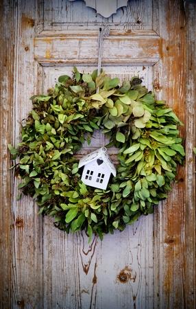 seasonal plant decoration on home door photo