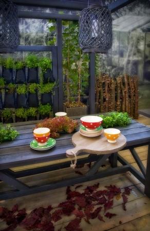 home grown: seasonal garden table with herbs  Stock Photo