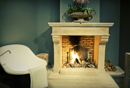 fire place: classic bathroom with fire place Stock Photo