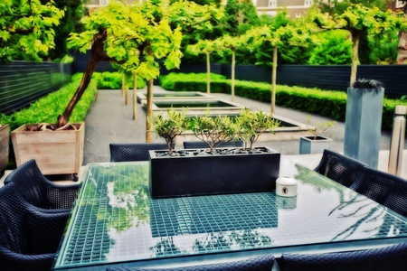 spring home garden with stylish glass table