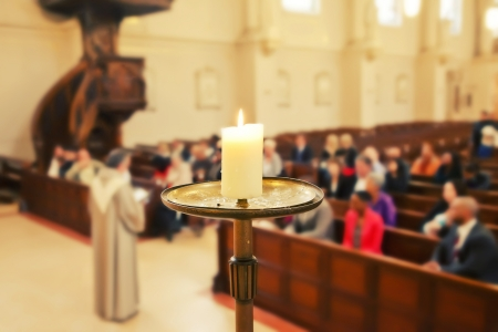 candle by Church service background  photo