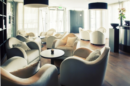 hotel reception: soft lounge chairs  by waiting room