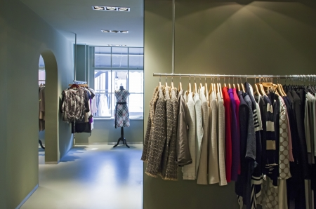 store interior: detail of fashion shop with clothes