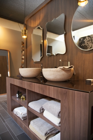 bathroom wooden design with morrows and towels photo