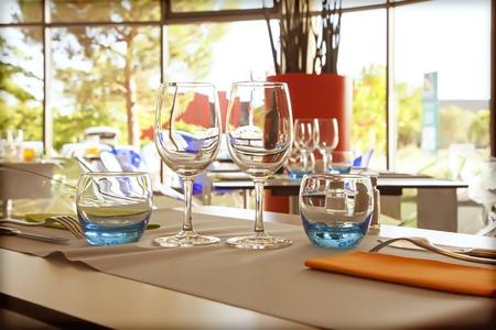 glasses on table in summer restaurant photo