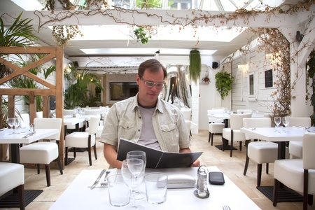 man in restaurant with menu  photo