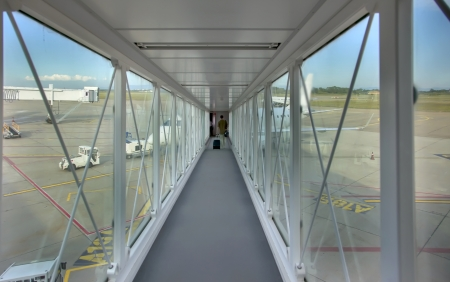 passenger aircraft: passengers  in departure tunnel by airport field Stock Photo