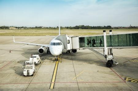regional: people in departure tunnel by airport field