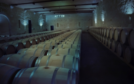 row of wine barrels in old winery photo