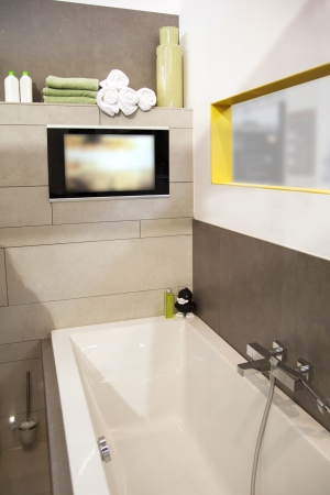 interior of modern bath room with tv photo