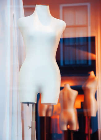 window of  shop with  mannequins without dress  photo