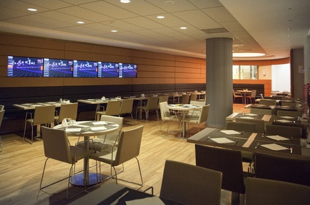 modern interior of restaurant with tv wall