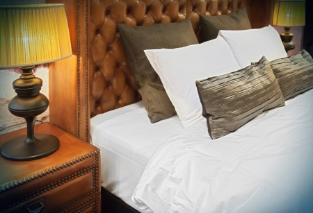 double bed with stylish lamps  photo