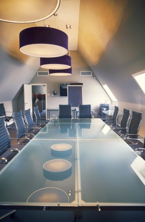 Boardroom meeting: empty business table in luxury office